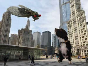 Cicada and dog wage titanic battle while far below, a city looks on with casual disinterest.